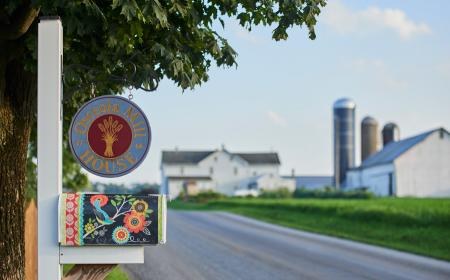 Welcome sign and Amish farm