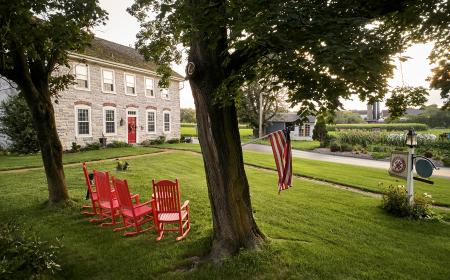 Front lawn with rocking chairs