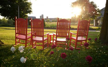Red rocking chairs on lawn